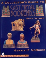 Cast metal bookends ,collectors guide with values.